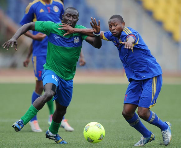 Rodney Strasser of Sierra Leone battles with Tony Tsabedze of Swaziland during the African Cup of Nations Qualifiers match between Swaziland and Sierra Leone in Somhlolo Stadium,  Mbabane on the 18 May 2014