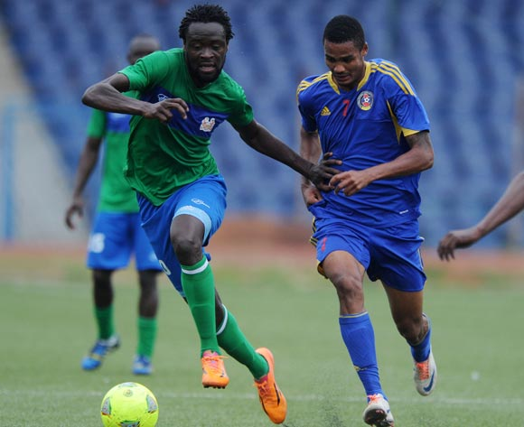 Kei Kamara of Sierra Leone challenged by Felix Badenhorst of Swaziland during the African Cup of Nations Qualifiers match between Swaziland and Sierra Leone in Somhlolo Stadium,  Mbabane on the 18 May 2014