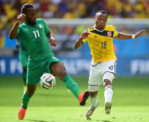 Ivory Coast's Didier Drogba battles for the ball with Colombia's Juan Camilo Zuniga