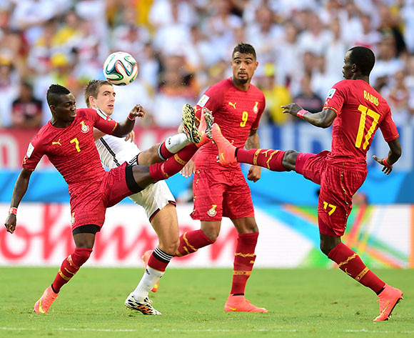 Ghana's Christian Atsu (left) Kevin Prince Boateng (centre) and Mohammed Rabiu (right) combine to deny Germany's Philipp Lahm