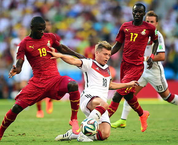 Germany's Toni Kroos is tackled by Ghana's Jonathan Mensah (left) as Ghana's Mohammed Rabiu (right) looks on