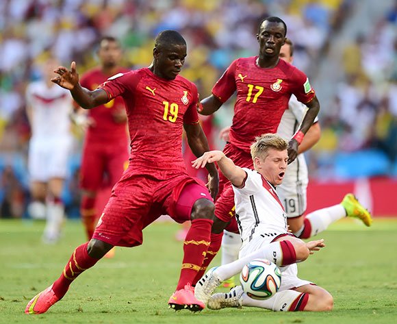 Germany's Toni Kroos is tackled by Ghana's Jonathan Mensah (left) as Ghana's Mohammed Rabiu (back) looks on