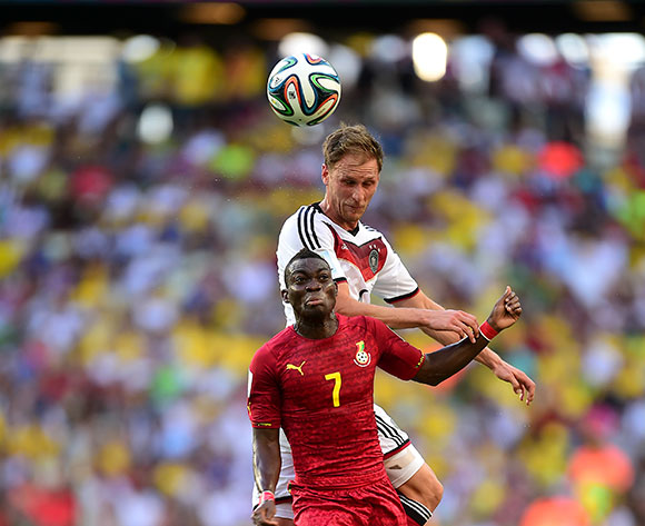 Germany's Benedikt Howedes wins an aerial dual with Ghana's Christian Atsu