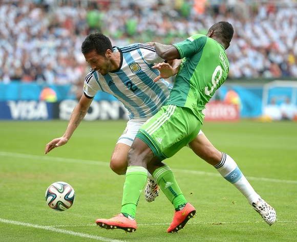 Nigeria's Emmanuel Emenike (right) and Argentina's Ezequiel Garay battle for the ball
