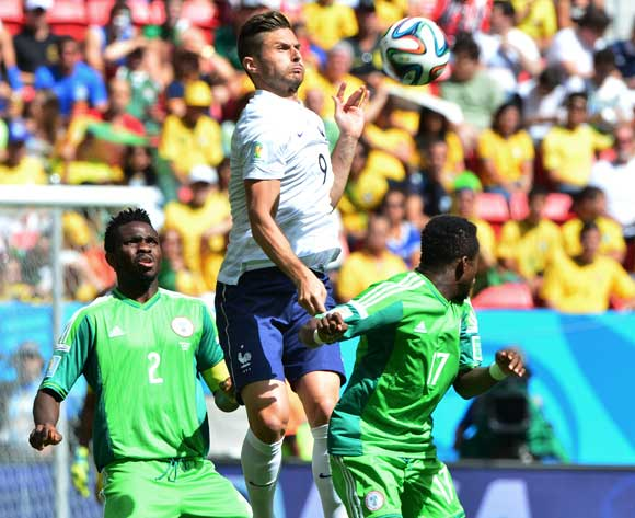 Olivier Giroud of France heads ball from Ogenyi Onazi (r) and Joseph Yobo of Nigeria during the 2014 Brazil World Cup Final Last 16 football match between France and Nigeria at the Estadio Nacional Brasilia, Brazil on 30 June 2014