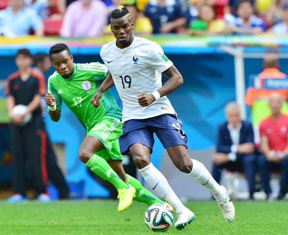 Paul Pogba of France gets away from Ogenyi Onazi of Nigeria during the 2014 Brazil World Cup Final Last 16 football match between France and Nigeria at the Estadio Nacional Brasilia, Brazil on 30 June 2014