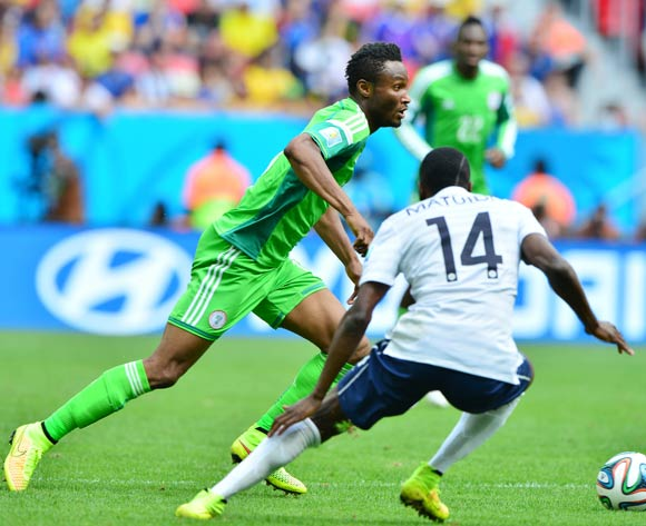 John Obi Mikel of Nigeria gets away from Blaise Matuidi of France  during the 2014 Brazil World Cup Final Last 16 football match between France and Nigeria at the Estadio Nacional Brasilia, Brazil on 30 June 2014