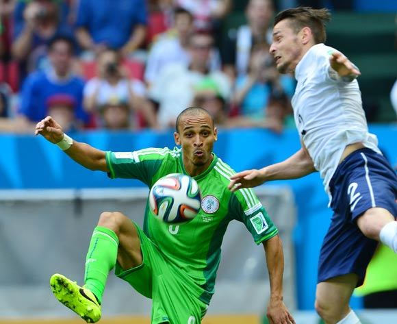 Peter Odemwingie of Nigeria controls ball away from Mathieu Debuchy of France during the 2014 Brazil World Cup Final Last 16 football match between France and Nigeria at the Estadio Nacional Brasilia, Brazil on 30 June 2014