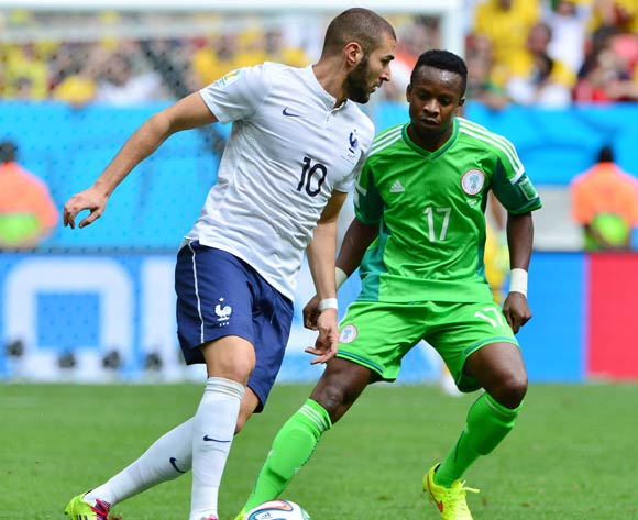 Karim Benzema of France shields ball from  Ogenyi Onazi of Nigeria during the 2014 Brazil World Cup Final Last 16 football match between France and Nigeria at the Estadio Nacional Brasilia, Brazil on 30 June 2014