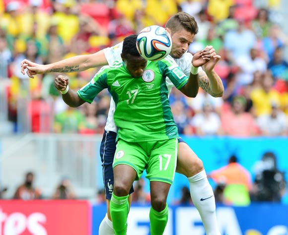 Ogenyi Onazi of Nigeria and Olivier Giroud of France challenge for the ball  during the 2014 Brazil World Cup Final Last 16 football match between France and Nigeria at the Estadio Nacional Brasilia, Brazil on 30 June 2014