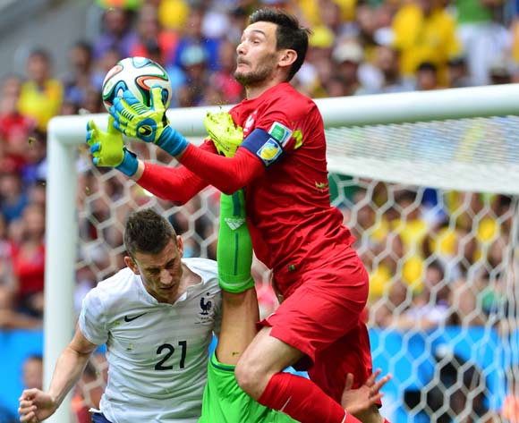 Hugo Lloris of France saves from teammate Laurent Koscielny and Peter Odemwingie of Nigeria   during the 2014 Brazil World Cup Final Last 16 football match between France and Nigeria at the Estadio Nacional Brasilia, Brazil on 30 June 2014