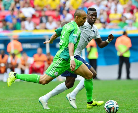 Peter Odemwingie of Nigeria evades challenge from Paul Pogba of France  during the 2014 Brazil World Cup Final Last 16 football match between France and Nigeria at the Estadio Nacional Brasilia, Brazil on 30 June 2014