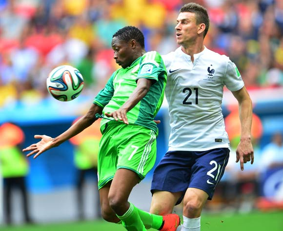 Ahmed Musa of Nigeria chests ball from Laurent Koscielny of France during the 2014 Brazil World Cup Final Last 16 football match between France and Nigeria at the Estadio Nacional Brasilia, Brazil on 30 June 2014