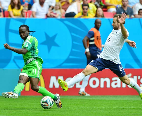 Victor Moses of Nigeria crosses past Yohan Cabaye of France  during the 2014 Brazil World Cup Final Last 16 football match between France and Nigeria at the Estadio Nacional Brasilia, Brazil on 30 June 2014