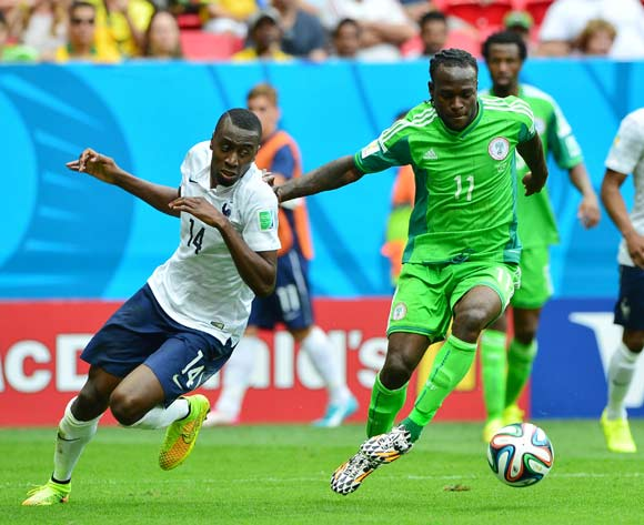 Victor Moses of Nigeria holds off Blaise Matuidi of France uring the 2014 Brazil World Cup Final Last 16 football match between France and Nigeria at the Estadio Nacional Brasilia, Brazil on 30 June 2014