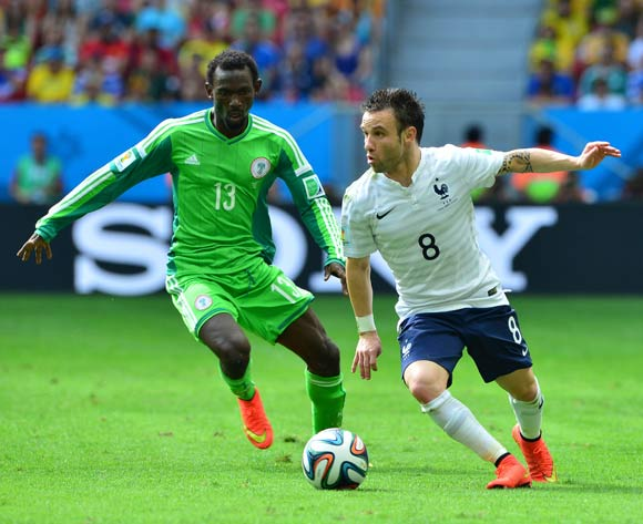 Mathieu Valbuena of France turns away from Juwon Oshaniwa of Nigeria  during the 2014 Brazil World Cup Final Last 16 football match between France and Nigeria at the Estadio Nacional Brasilia, Brazil on 30 June 2014