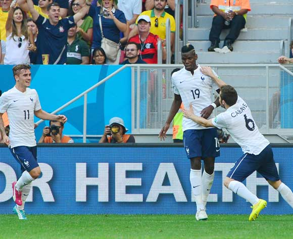 Paul Pogba of France celebrates goal with Mathieu Valbuena and Antoine Griezmann (l)  during the 2014 Brazil World Cup Final Last 16 football match between France and Nigeria at the Estadio Nacional Brasilia, Brazil on 30 June 201