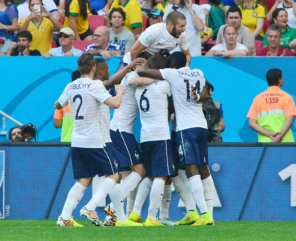 France players embrace goalscorer Paul Pogba during the 2014 Brazil World Cup Final Last 16 football match between France and Nigeria at the Estadio Nacional Brasilia, Brazil on 30 June 2014