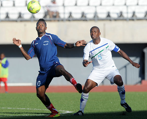 Sekou Oliseh of Liberia challenged by Moitheri Ntobo of Lesotho during the 2015 African Cup of Nations Qualifier match between Lesotho and Liberia at Setsoto Stadium,  Maseru, Lesotho on the 01 June 2014