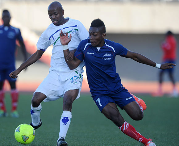 Chris Jones of Liberia challenged by Bushy Moletsawe of Lesotho during the 2015 African Cup of Nations Qualifier match between Lesotho and Liberia at Setsoto Stadium,  Maseru, Lesotho on the 01 June 2014