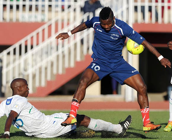 Sekou Oliseh of Liberia challenged by Nkau Lerotholi of Lesotho during the 2015 African Cup of Nations Qualifier match between Lesotho and Liberia at Setsoto Stadium,  Maseru, Lesotho on the 01 June 2014