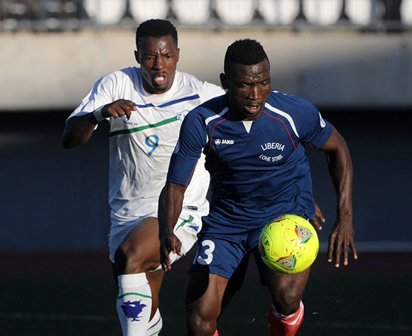 Simujka Aloysius of Liberia battles with Tale Thapelo of Lesotho during the 2015 African Cup of Nations Qualifier match between Lesotho and Liberia at Setsoto Stadium,  Maseru, Lesotho on the 01 June 2014