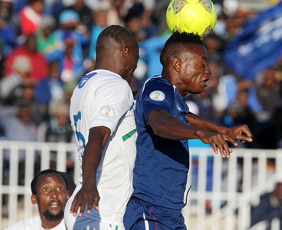 Sam Kollie of Liberia battles with Moitheri Ntobo of Lesotho during the 2015 African Cup of Nations Qualifier match between Lesotho and Liberia at Setsoto Stadium,  Maseru, Lesotho on the 01 June 2014