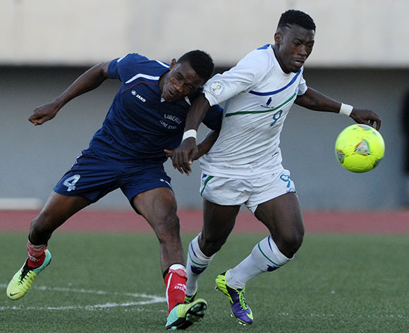Tale Thapelo of Lesotho battles with Jetoh Prince of Liberia during the 2015 African Cup of Nations Qualifier match between Lesotho and Liberia at Setsoto Stadium,  Maseru, Lesotho on the 01 June 2014