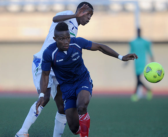 Chris Jones of Liberia battles with Sepiriti Malefawe of Lesotho during the 2015 African Cup of Nations Qualifier match between Lesotho and Liberia at Setsoto Stadium,  Maseru, Lesotho on the 01 June 2014