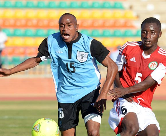 Olerile Edwin of Botswana battles with Styve Nzigamasabo of Burundi during the 2015 African Cup of Nations Qualifier match between Botswana and Burundi on the 01 June 2014 at Lobatse Sports Complex in Botswana