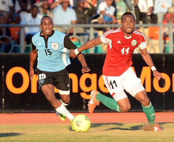 Selemani Ndikumana of Burundi battles with Olerile Edwin of Botswana during the 2015 African Cup of Nations Qualifier match between Botswana and Burundi on the 01 June 2014 at Lobatse Sports Complex in Botswana