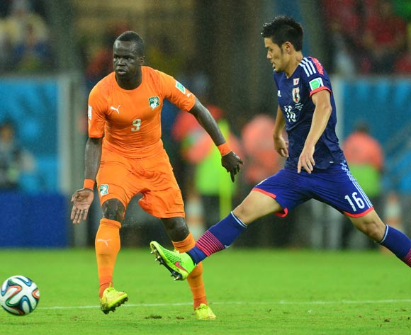Ismael Tiote of Ivory Coast clears ball from Hotaru Yamaguchi of Japan  during the 2014 Brazil World Cup Finals, Group C, football match between Ivory Coast and Japan at the Arena Pernambuco in Recife, Brazil on 14 June 2014