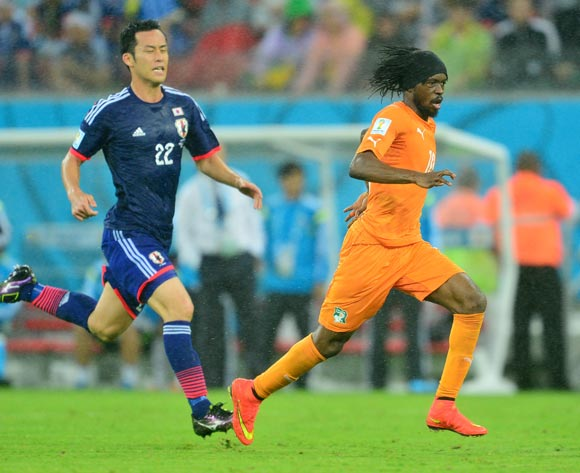 Gervinho of Ivory Coast gets away from Maya Yoshida of Japan during the 2014 Brazil World Cup Finals, Group C, football match between Ivory Coast and Japan at the Arena Pernambuco in Recife, Brazil on 14 June 2014