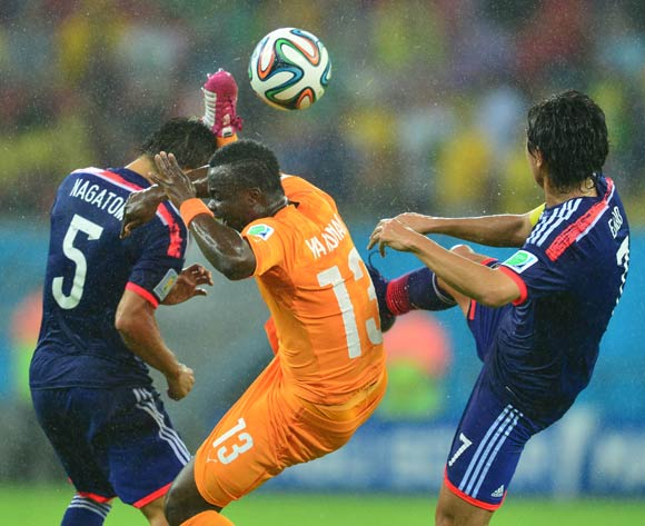 Konan Ya of Ivory Coast challenged by Yuto Nagatomo (l) and Yasuhito Endo of Japan (r) during the 2014 Brazil World Cup Finals, Group C, football match between Ivory Coast and Japan at the Arena Pernambuco in Recife, Brazil on 14 June 2014