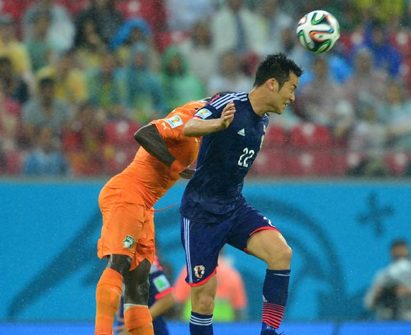 Maya Yoshida of Japan beats Ismael Tiote of Ivory Coast in the air  during the 2014 Brazil World Cup Finals, Group C, football match between Ivory Coast and Japan at the Arena Pernambuco in Recife, Brazil on 14 June 2014