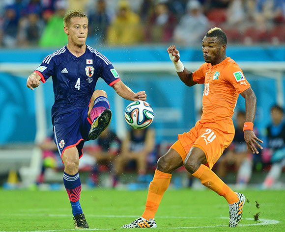 Keisuke Honda of Japan challenged by Die Serey of Ivory Coast  during the 2014 Brazil World Cup Finals, Group C, football match between Ivory Coast and Japan at the Arena Pernambuco in Recife, Brazil on 14 June 2014 ©Gavin Barker/BackpagePix