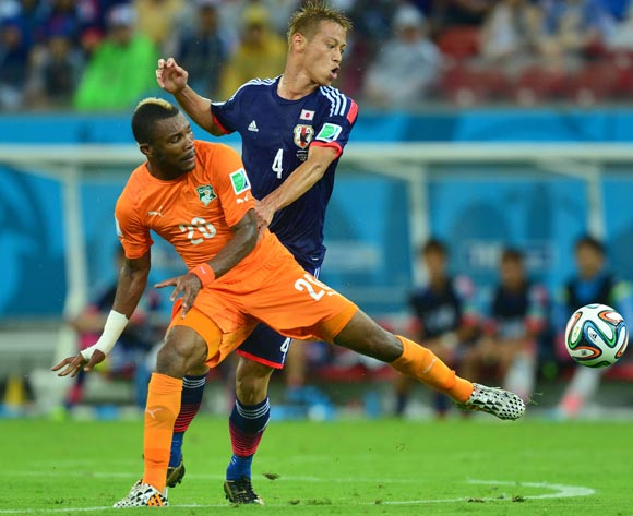 Die Serey of Ivory Coast challenged by Keisuke Honda of Japan during the 2014 Brazil World Cup Finals, Group C, football match between Ivory Coast and Japan at the Arena Pernambuco in Recife, Brazil on 14 June 2014