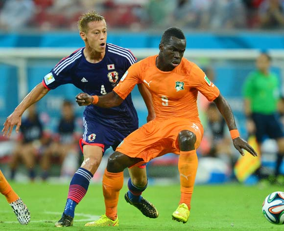 Ismael Tiote of Ivory Coast shields ball from Keisuke Honda of Japan during the 2014 Brazil World Cup Finals, Group C, football match between Ivory Coast and Japan at the Arena Pernambuco in Recife, Brazil on 14 June 2014