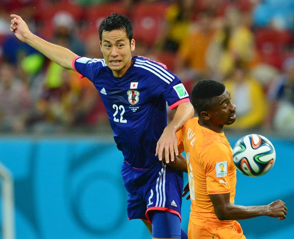 Maya Yoshida of Japan heads ball past Salomon Kalou of Ivory Coast  during the 2014 Brazil World Cup Finals, Group C, football match between Ivory Coast and Japan at the Arena Pernambuco in Recife, Brazil on 14 June 2014