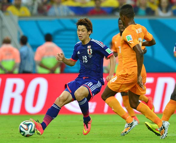 Yuya Osako of Japan plays ball past Salomon Kalou of Ivory Coast during the 2014 Brazil World Cup Finals, Group C, football match between Ivory Coast and Japan at the Arena Pernambuco in Recife, Brazil on 14 June 2014