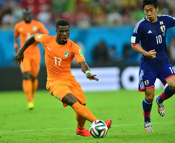 Serge Aurier of Ivory Coast gets away from Shinji Kagawa of Japan during the 2014 Brazil World Cup Finals, Group C, football match between Ivory Coast and Japan at the Arena Pernambuco in Recife, Brazil on 14 June 2014 ©Gavin Barker/BackpagePix