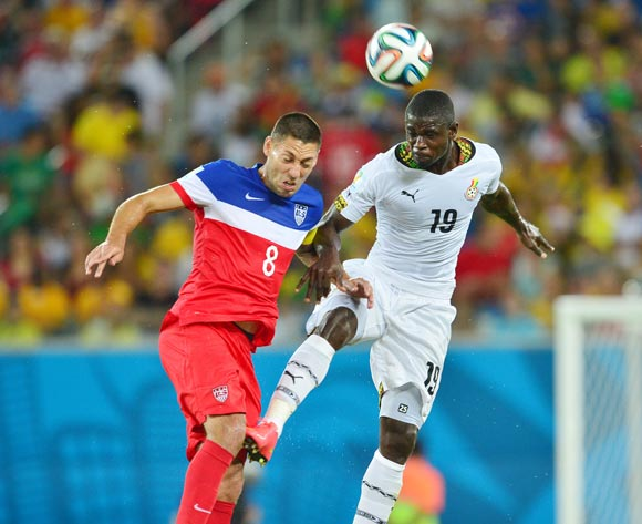 Jonathan Mensah of Ghana beats Clint Dempsey of the United States of America  in the air during the 2014 Brazil World Cup Final Group G football match between Ghana and USA at the Estadio das Dunas in Natal, Brazil on 16 June 2014