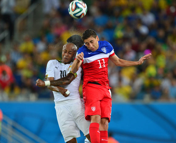 Andre Ayew of Ghana and Alejandro Bedoya of the United States of America during the 2014 Brazil World Cup Final Group G football match between Ghana and USA at the Estadio das Dunas in Natal, Brazil on 16 June 2014