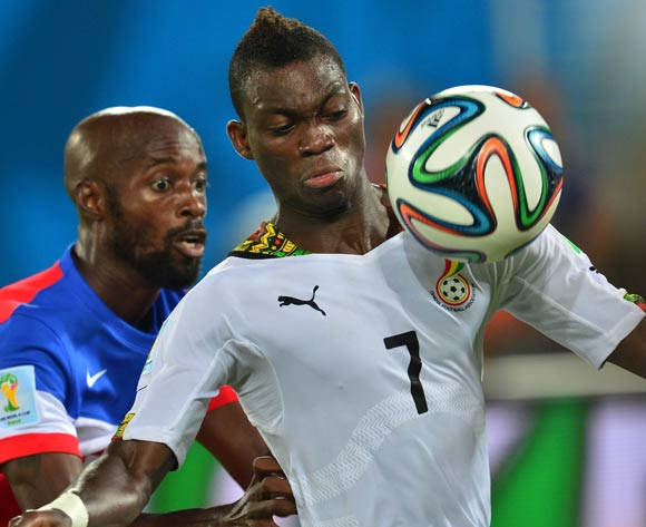 Christian Atsu of Ghana shields ball from Damarcus Beasley of USA   during the 2014 Brazil World Cup Final Group G football match between Ghana and USA at the Estadio das Dunas in Natal, Brazil on 16 June 2014