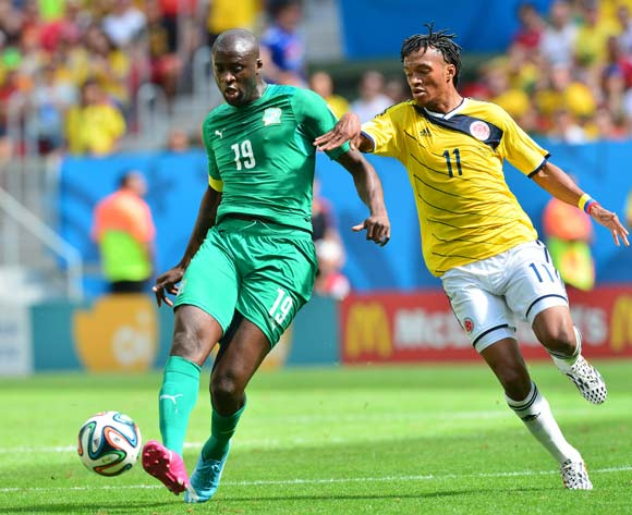 Yaya Toure of Ivory Coast and Juan Cuadrado of Colombia during the 2014 Brazil World Cup Final Group C football match between Ghana and USA at the Estadio das Dunas in Natal, Brazil on 16 June 2014