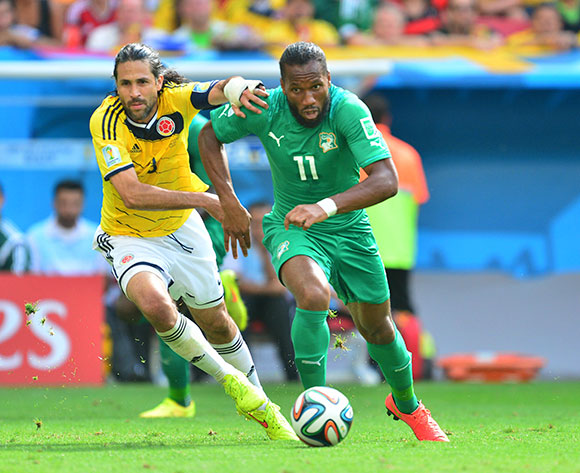 Didier Drogba of Ivory Coast gets away from Mario Yepes of Colombia on 19 June 2014 ©Gavin Barker/BackpagePix