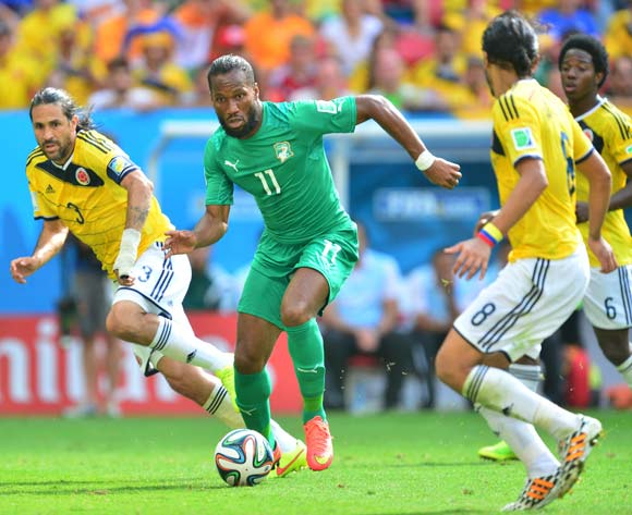 Didier Drogba of Ivory Coast gets away from Mario Yepes of Colombia  during the 2014 Brazil World Cup Final Group C football match between Colombia and Ivory Coast at the Estadio Nacional Brasilia, Brazil on 19 June 2014