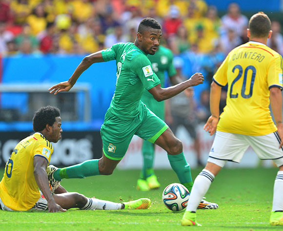 Salomon Kalou of Ivory Coast tackled by Carlos Sanchez of Colombia on 19 June 2014 ©Gavin Barker/BackpagePix