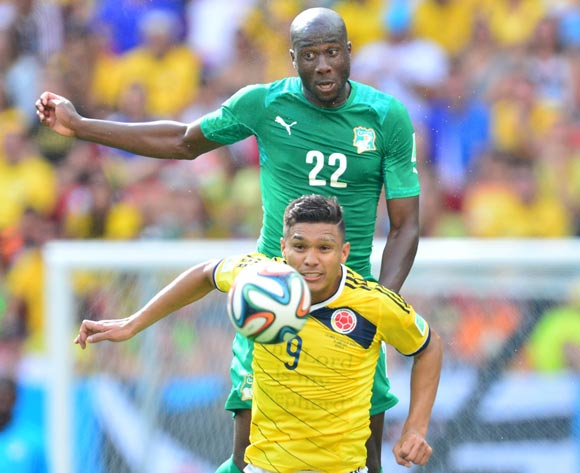 Souleymane Bamba of Ivory Coast beats Teofilo Gutierrez of Colombia  during the 2014 Brazil World Cup Final Group C football match between Colombia and Ivory Coast at the Estadio Nacional Brasilia, Brazil on 19 June 2014