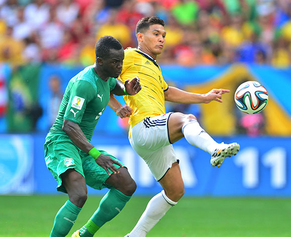Teofilo Gutierrez of Colombia controls ball from Ismael Tiote of Ivory Coast during the 2014 Brazil World Cup Final Group C football match between Colombia and Ivory Coast at the Estadio Nacional Brasilia, Brazil on 19 June 2014 ©Gavin Barker/BackpagePix